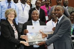 In the Middle is Mr. Vitus Kato Mulindwa –Deputy Executive Director Corporate Services and  Ms. Nooreen Prendiville the Deputy Country Representative UNICEF  launching the ESRI  MAP BOOK during the GIS Day Celebrations Held at Statistics House Kampala.